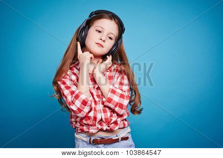 Pretty girl with headphones listening to music
