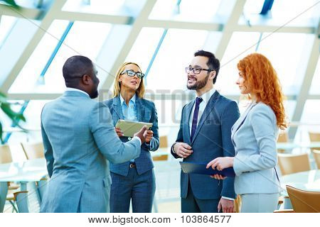 Business co-workers interacting at meeting
