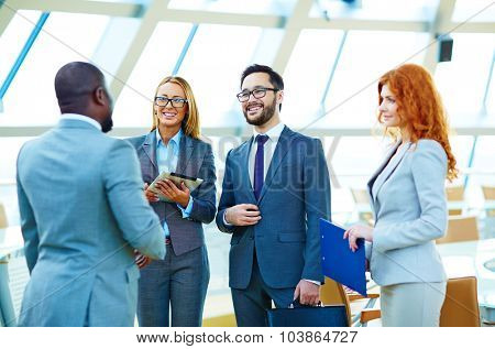 Happy multi-ethnic business people having consultation