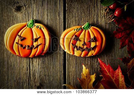 Halloween homemade gingerbread cookie over wooden background