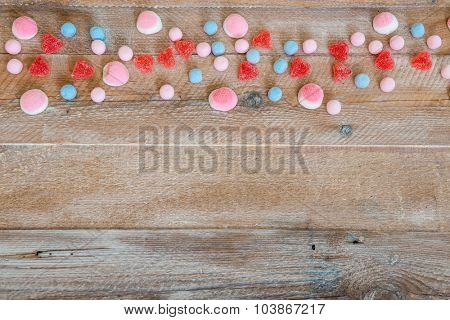 candy in the form of heart on wooden background