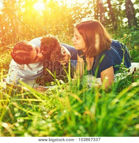 Beautiful couple with dog outdoors