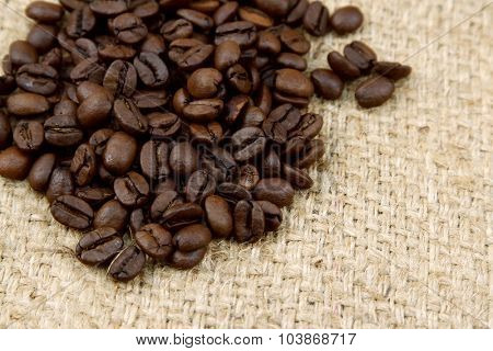 Closeup of coffee beans on sacking