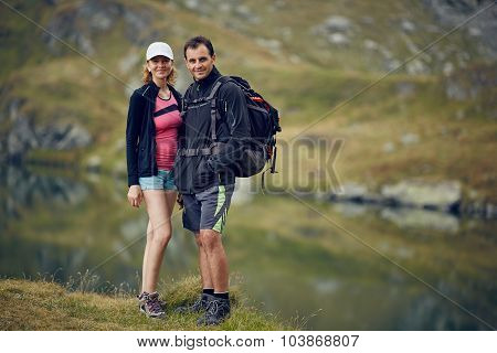 Couple Of Hikers Near The Lake