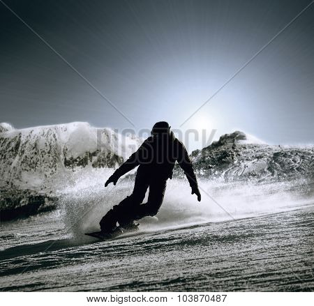 Snowboarder silhouette with mountain background