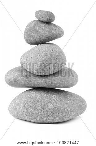 Pile of five balanced rocks on plain background