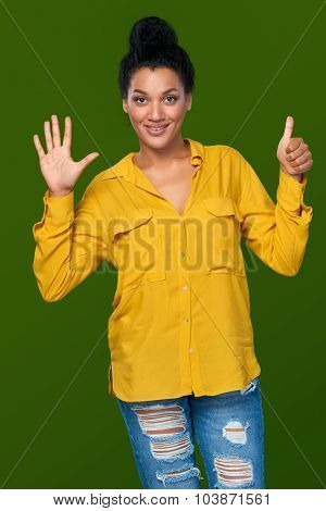 Woman showing six fingers