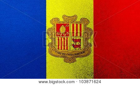 Flag of Andorra painted on glass texture.