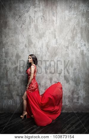 Beautiful girl in a red dress