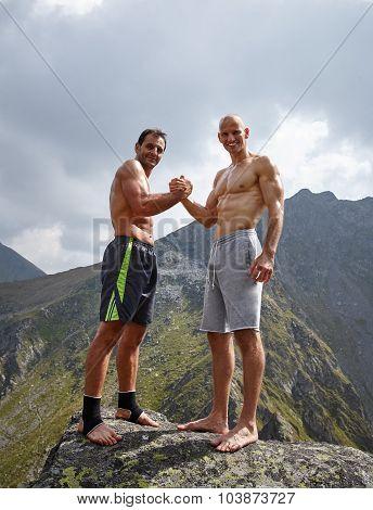 Two Sportive Men Shaking Hands