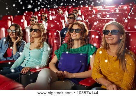 cinema, technology, entertainment and people concept - happy female friends with 3d glasses watching movie in theater with snowflakes