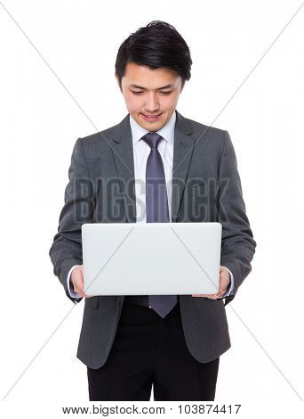Asian Young Businessman read on the laptop computer