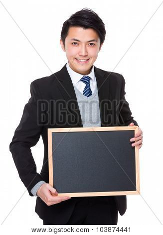 Asian young businessman show with chalkboard