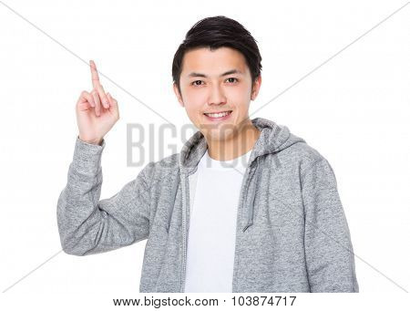 Asian man showing finger point up