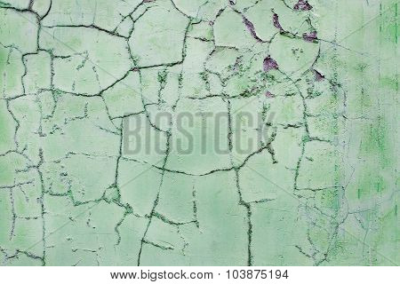 Cracked Plaster On Green Wall