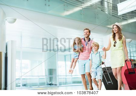 Family with children at the airport