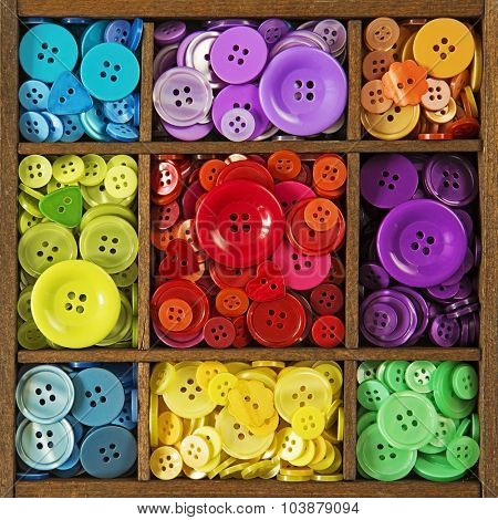 Colorful buttons in the brown wooden box