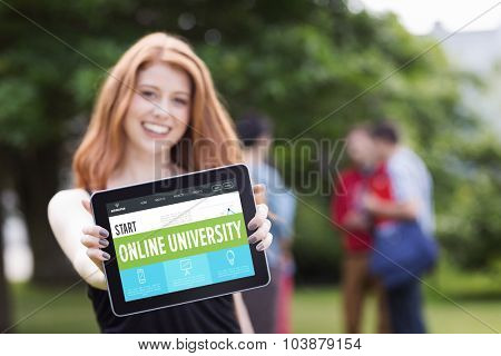 Online university interface against pretty student smiling at camera using tablet pc