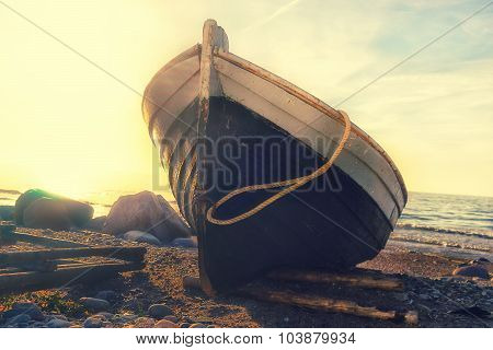 Fishing Boat On The Beach At Sunset