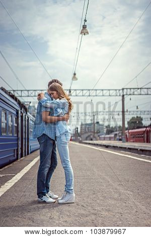 Couple hugging in a train station