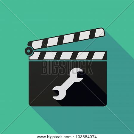 Long Shadow Clapper Board With A Wrench
