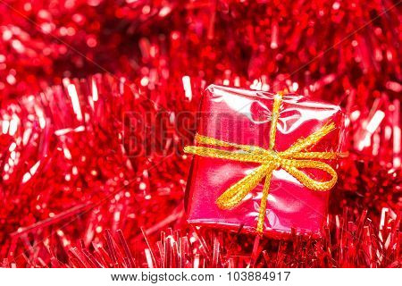 Shiny Tinsel And Little Gift Box