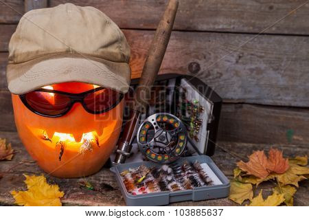 Halloween Pumpkin In Hat With Fly-fishing Tackles