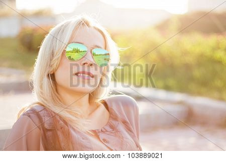 Young Thoughtful Woman Sitting On Stairs