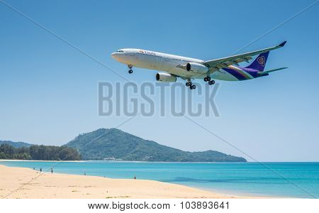 PHUKET, THAILAND - MARCH 11: Landing airplane at Phuket international airport on 11 March, 2014.