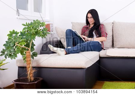 Girl Reading Book On The Sofa
