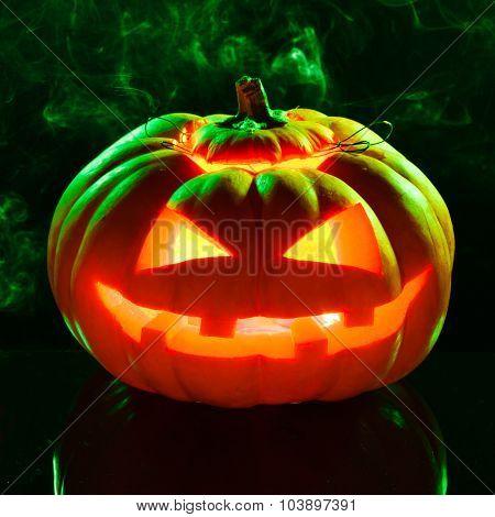 Smoking scary halloween pumpkin head