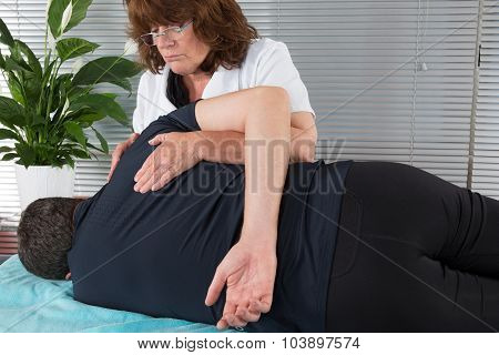 Physiotherapist Female Doing Back Massage In Medical Office