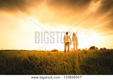 Silhouette of a Two Persons On Sunset