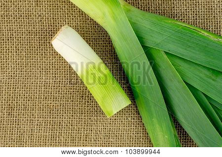 Aerial Of Delicious Fresh Leek On Hessian Material