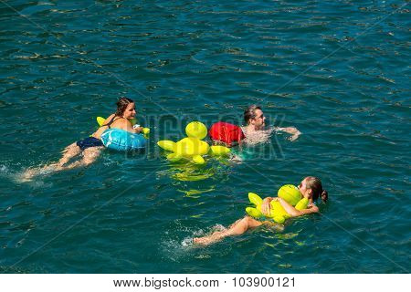 People Have Fun Participating The Swimming Summer Festival