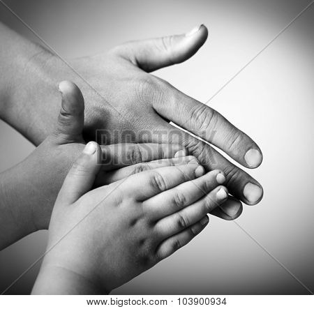 children and adults hands on a white background