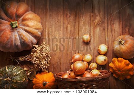 autumn pumpkins and other fruits and vegetables on a wooden table
