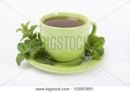 Green Cup Of  Tea With Lemon Balm Herb  .