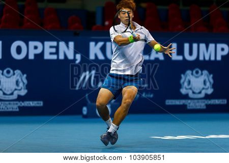 KUALA LUMPUR, MALAYSIA - SEPTEMBER 26, 2015: Woong Sun Jun of South Korea plays in his qualifying match in the Malaysian Open 2015 Tennis tournament held at the Putra Stadium, Malaysia.