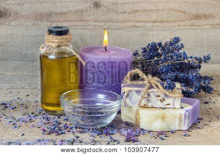 Lavender Oil, Lavender Flowers, Handmade Soap And  Sea Salt With Burning Aromatherapy Candle.