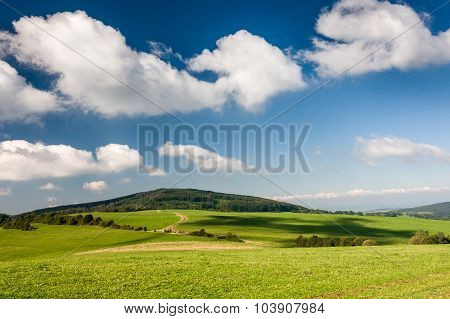Beautiful Summer Countryside Under Blue Sky With Clouds