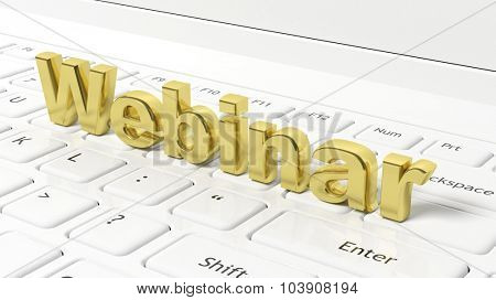 Webinar 3D gold text on laptop keyboard