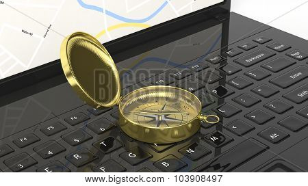 Golden compass on laptop keyboard