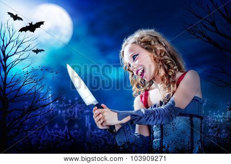 Young Vampire With Knife At Full Moon.