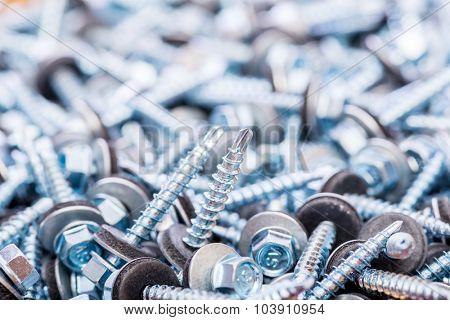 Many screws arranged as background