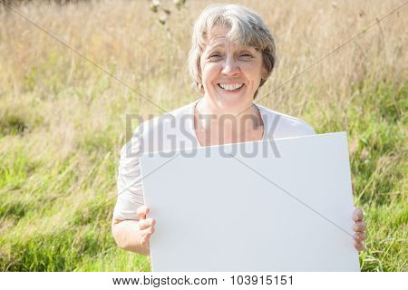 Old age woman holding blank white sign