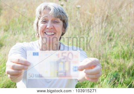 Old age woman holding fifty euro