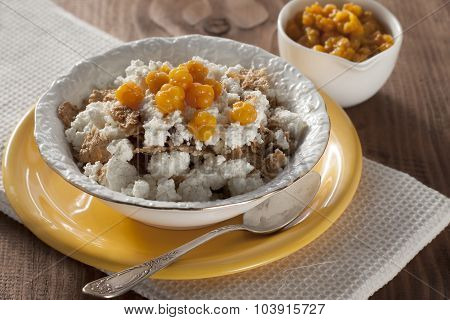 Cottage Cheese With Cloudberries And Cereal Flakes  .