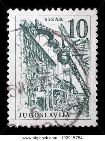 YUGOSLAVIA - CIRCA 1958: Stamp printed in Yugoslavia shows a Steel Plant, Sisak, with the same inscription, from series