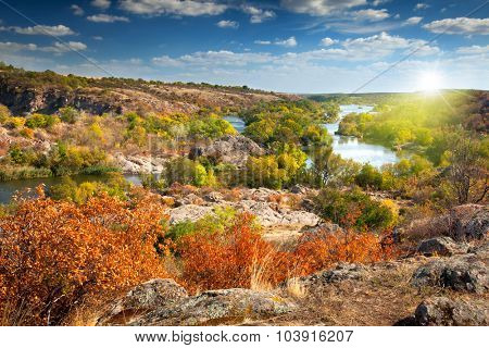 Beautiful Sunny Autumn Day - Panoramic view of the river, colorful trees and big rocks - wallpaper